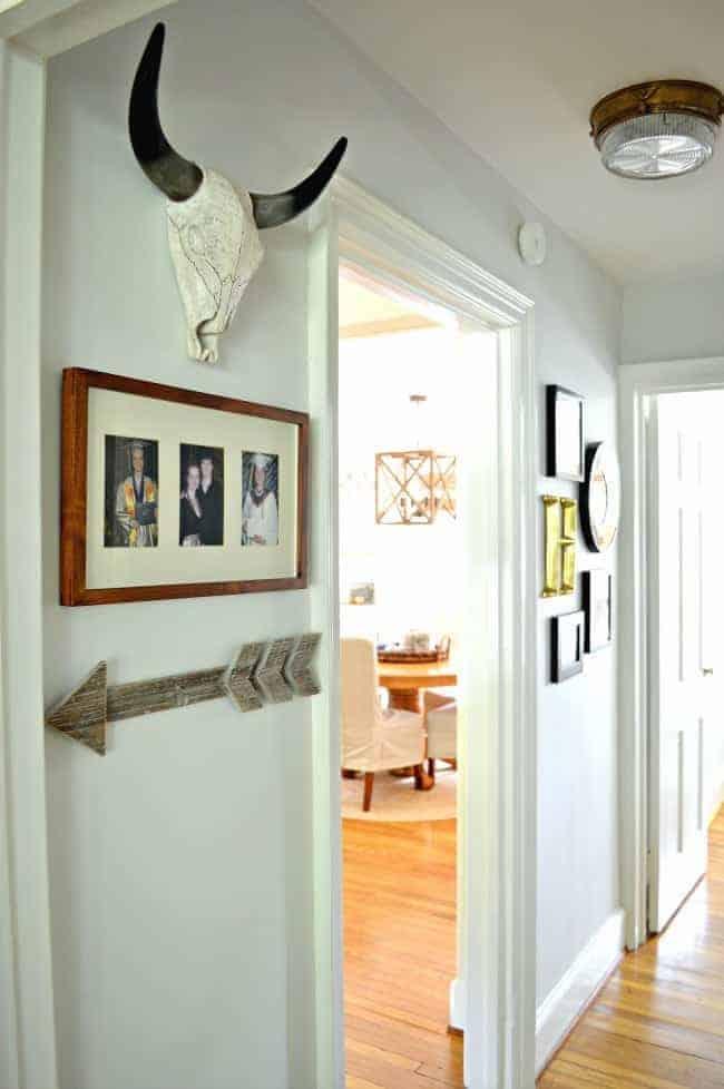 A small hallway redo using gray paint, some farmhouse decor and lots of family photos. chatfieldcourt.com