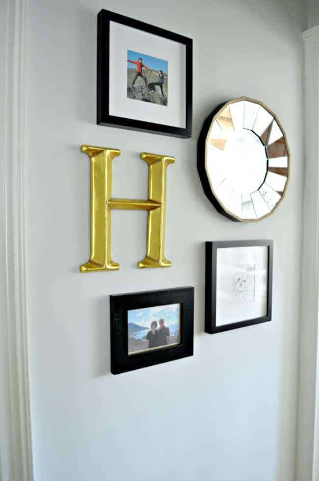 A small hallway redo using gray paint, a bit of farmhouse decor and some family photos. www.chatfieldcourt.com