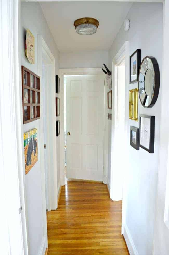 A small hallway redo using gray paint, some farmhouse decor and family photos. www.chatfieldcourt.com