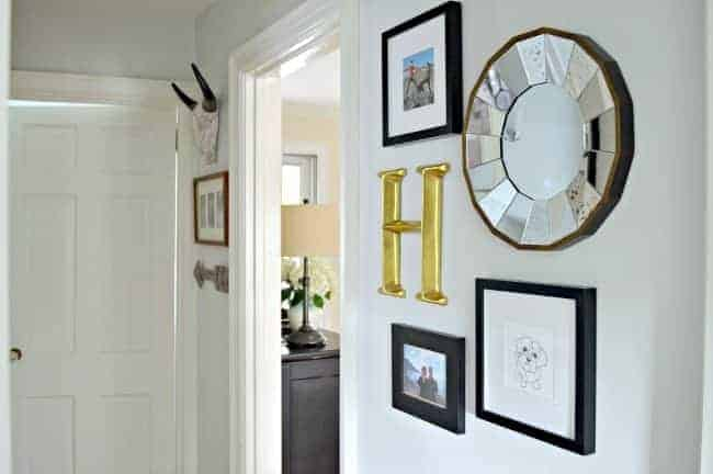 A small hallway redo using gray paint, a bit of farmhouse decor and lots of family photos. www.chatfieldcourt.com