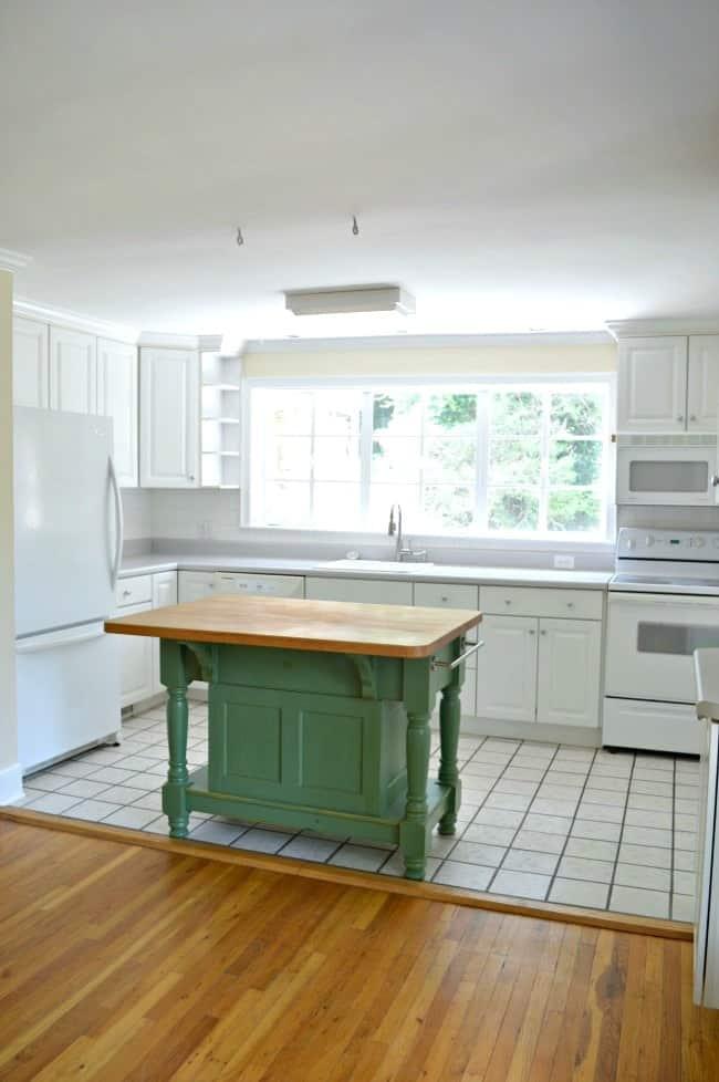 Green butcher block kitchen island.