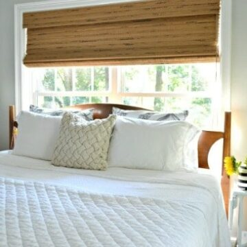 A bedroom with a bed and window