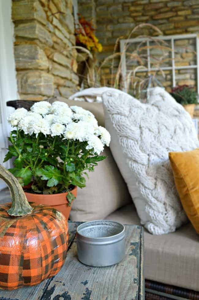 A simple fall front porch tour with mums, a cozy throw and pillows. chatfieldcourt.com