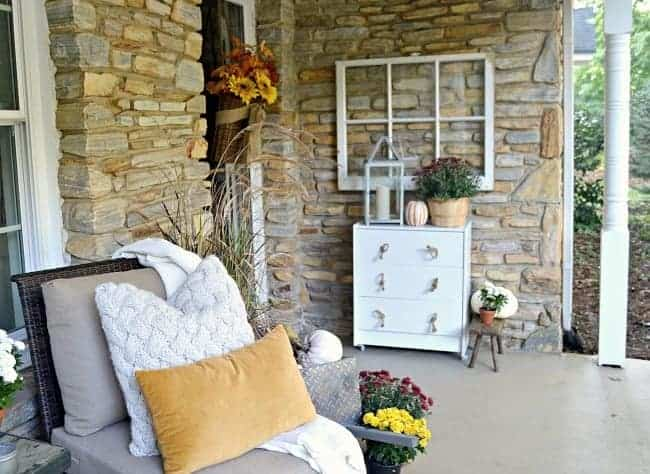 Take a tour of this pretty fall front porch with a cozy seating area. chatfieldcourt.com
