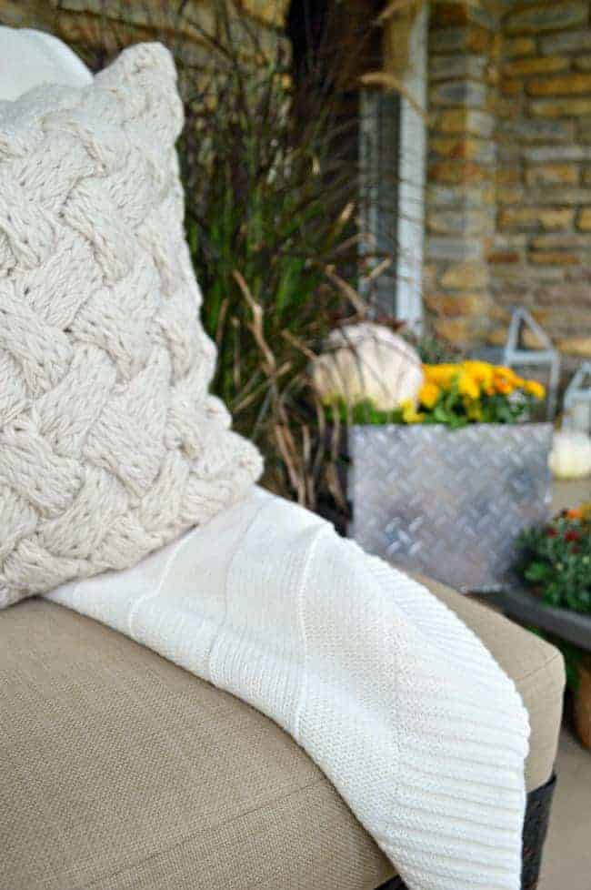 A simple fall front porch tour with a cozy throw and pillows. chatfieldcourt.com