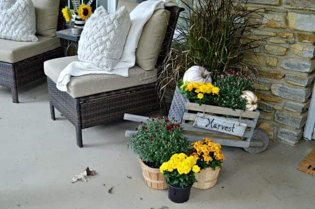 A fall front porch tour with mums, a cozy throw and pillows. chatfieldcourt.com