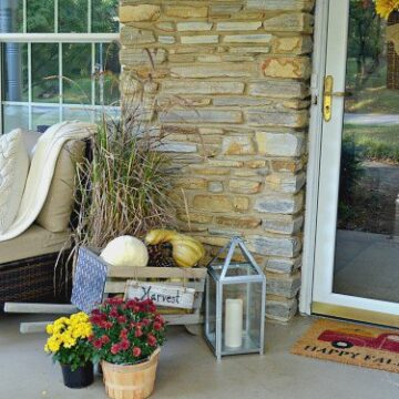 A front porch decorated for fall