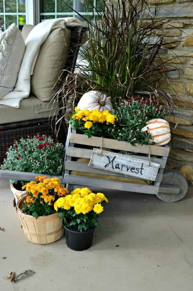 Building this rustic, industrial wheelbarrow, a pretty fall touch to the front porch. Learn to build your own at THD DIH Workshop near you. www.chatfieldcourt.com
