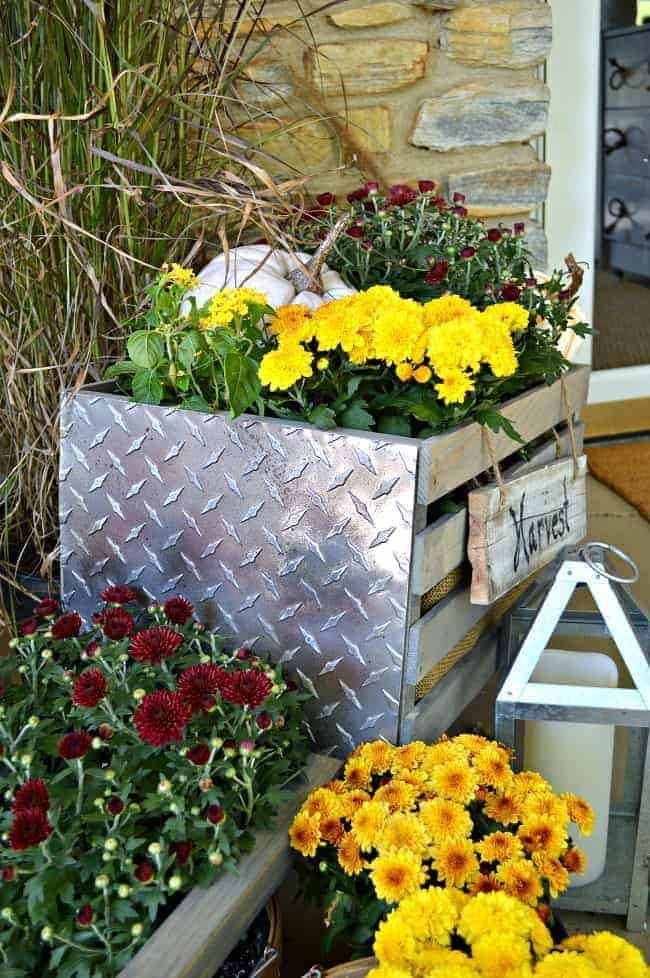How to build a rustic, industrial wheelbarrow, a pretty fall touch for the front porch. Learn to build your own at THD DIH Workshop near you. chatfieldcourt.com