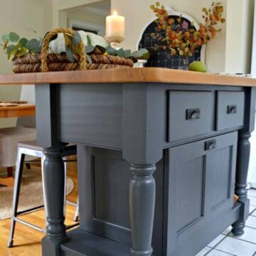 gray painted kitchen island with wood top