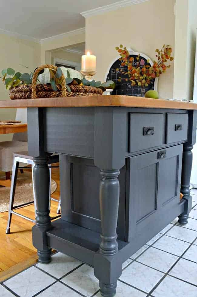 A super easy kitchen island makeover using Benjamin Moore Wrought Iron.