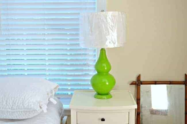 green lamp on nightstand that will get a spray paint makeover