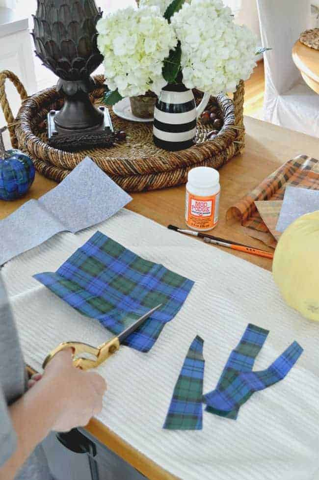 A fun and easy DIY using a Dollar Store pumpkin and plaid tissue paper. chatfieldcourt.com