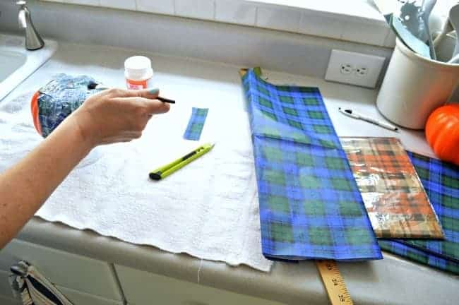 A fun and easy DIY using a Dollar Store pumpkin and plaid tissue paper. chatfieldcourt.com