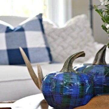 Blue plaid pumpkin on a coffee table