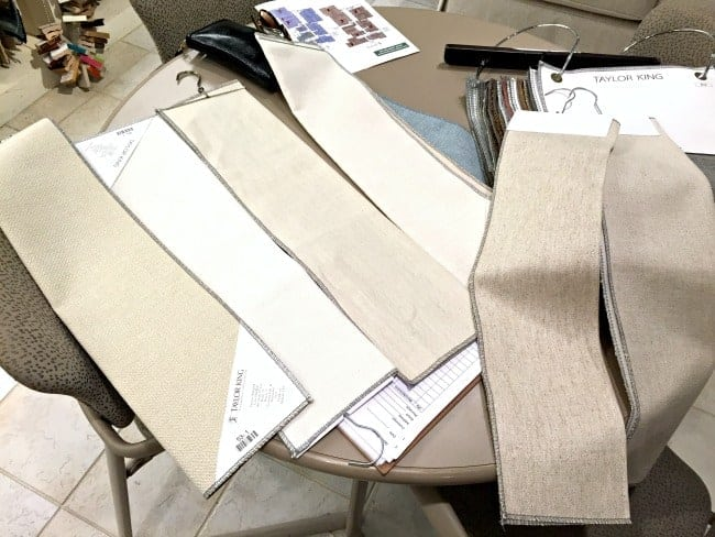 neutral sofa upholstery fabric samples laid out on table