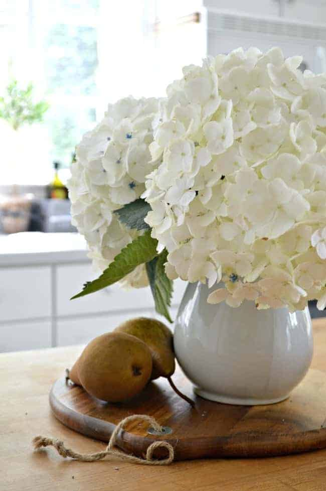 Natural fall touches with pretty hydrangeas in the kitchen for a Seasonal Harvest Tour.