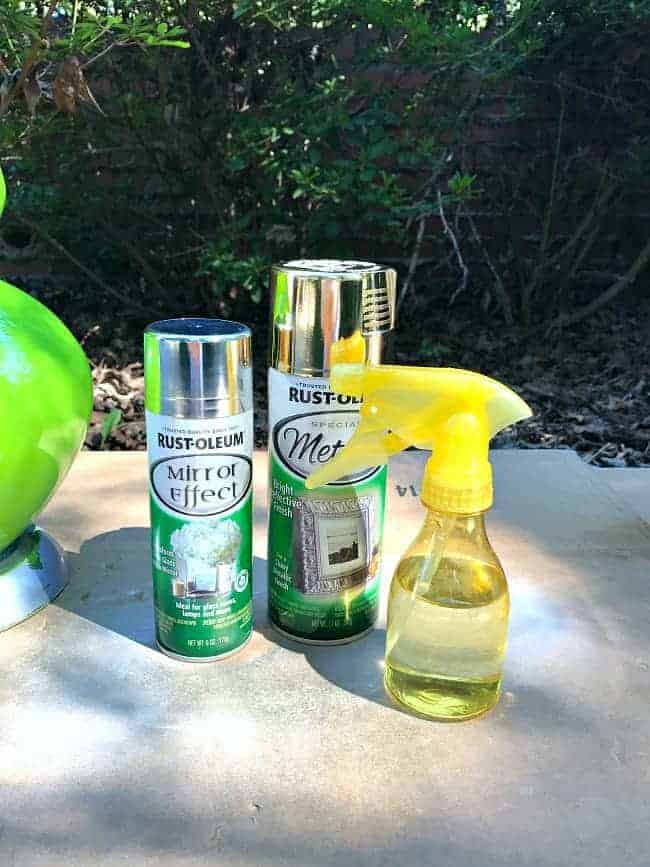 Love this easy and inexpensive lamp makeover using spray paint and water and vinegar to give it an aged mercury glass look.