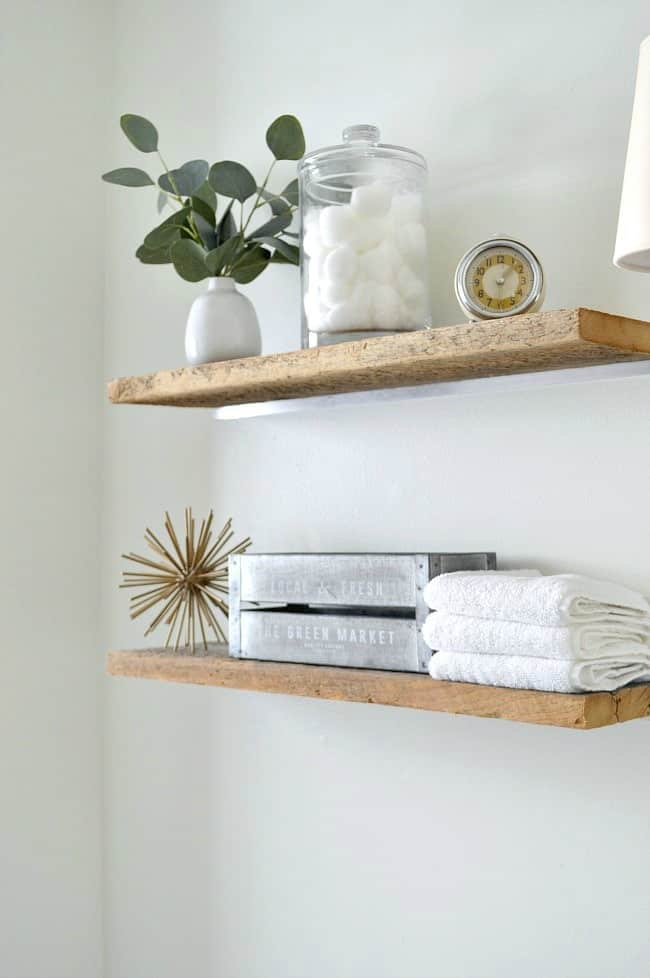 How to add a rustic touch to a small bathroom by installing a couple of DIY faux floating shelves over the toilet for much needed storage.