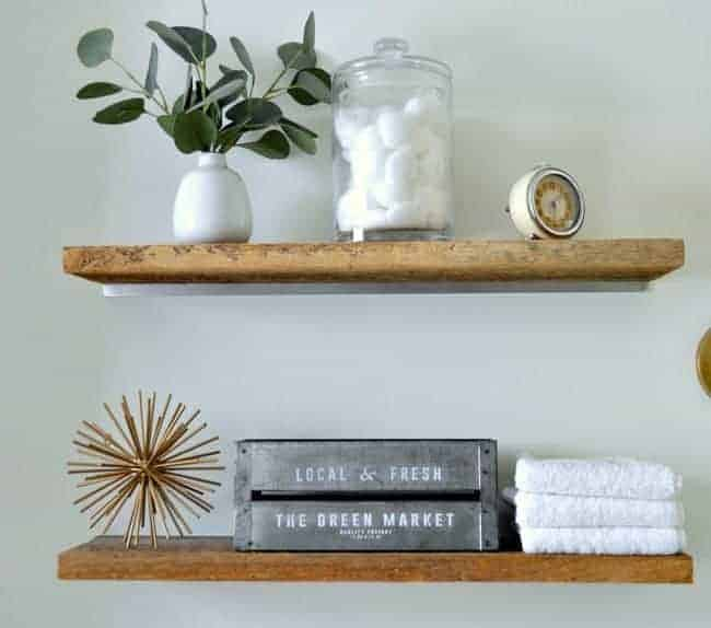 How to add a rustic touch to a small bathroom by installing DIY faux floating shelves over the toilet for much needed storage. www.chatfieldcourt.com
