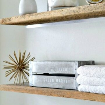 bathroom shelves with decor and towels on them