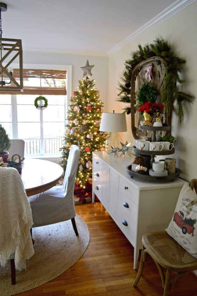Christmas tree in corner of cottage dining room with white sideboard