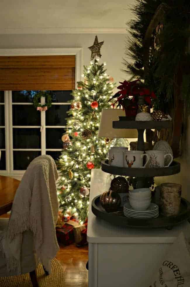 The tree at dusk in our rustic and simple cozy Christmas cottage decorated in red with touches of gold. www.chafieldcourt.com