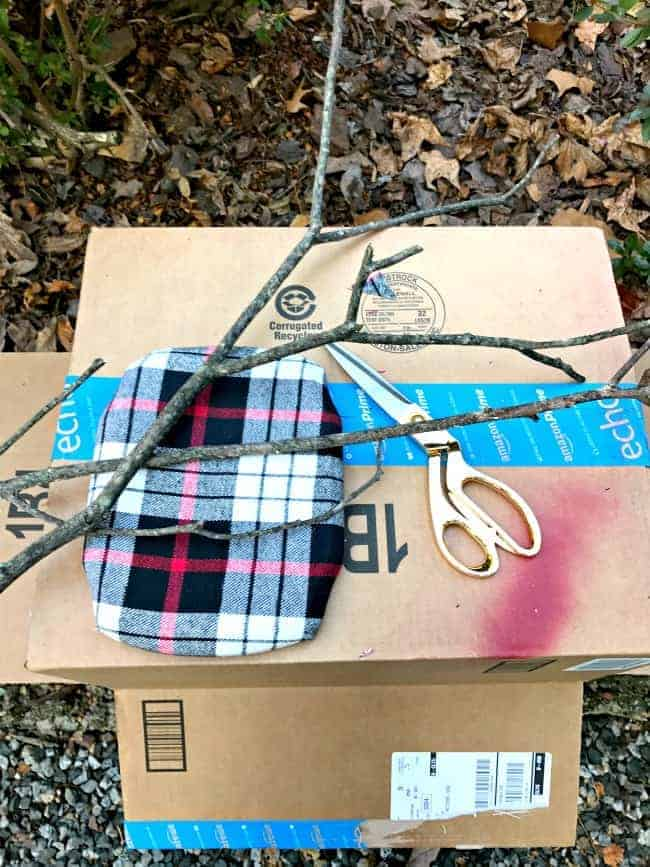 A DIY faux branch antler craft. A quick, easy and cheap project using scrap fabric and branches.