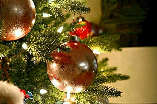 Turn plain glass ornaments into rustic, glam mercury glass Christmas ornaments with just a few supplies. An easy DIY to dress up your tree.