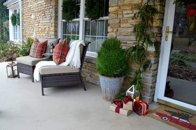 Decorating ideas to create a cozy Christmas porch using fresh garland, lanterns, candles and a few rustic touches. www.chatfieldcourt.com