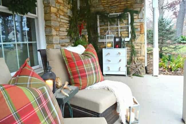 Decorating ideas for a cozy Christmas front porch using fresh garland, candles and a few rustic touches. www.chatfieldcourt.com