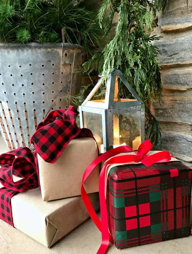 Decorating ideas for a cozy Christmas porch using fresh garland, lanterns and a few rustic touches. www.chatfieldcourt.com