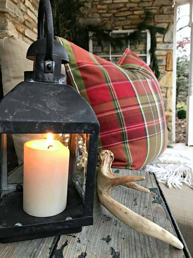 Decorating ideas to help you create a cozy Christmas porch using fresh garland, candles and a few rustic touches. www.chatfieldcourt.com