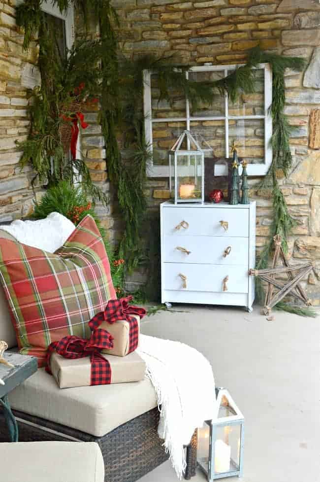 Easy decorating ideas for a cozy Christmas front porch using fresh garland, candles and a few rustic touches. www.chatfieldcourt.com