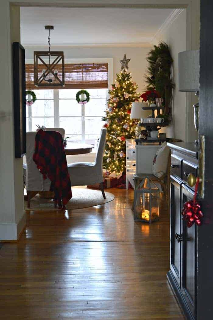 Decorating ideas to create a cozy Christmas porch using fresh garland and a few rustic touches. www.chatfieldcourt.com