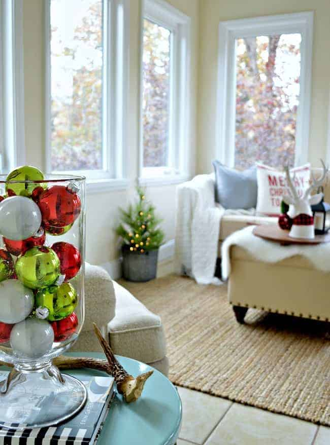 The sunroom in our rustic and simple cozy Christmas cottage decorated in red with touches of gold. www.chafieldcourt.com