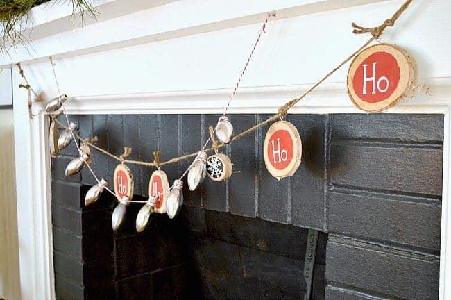 A festive and easy DIY Christmas banner made from birch wood slices and painted with red chalkboard paint. www.chatfieldcourt.com