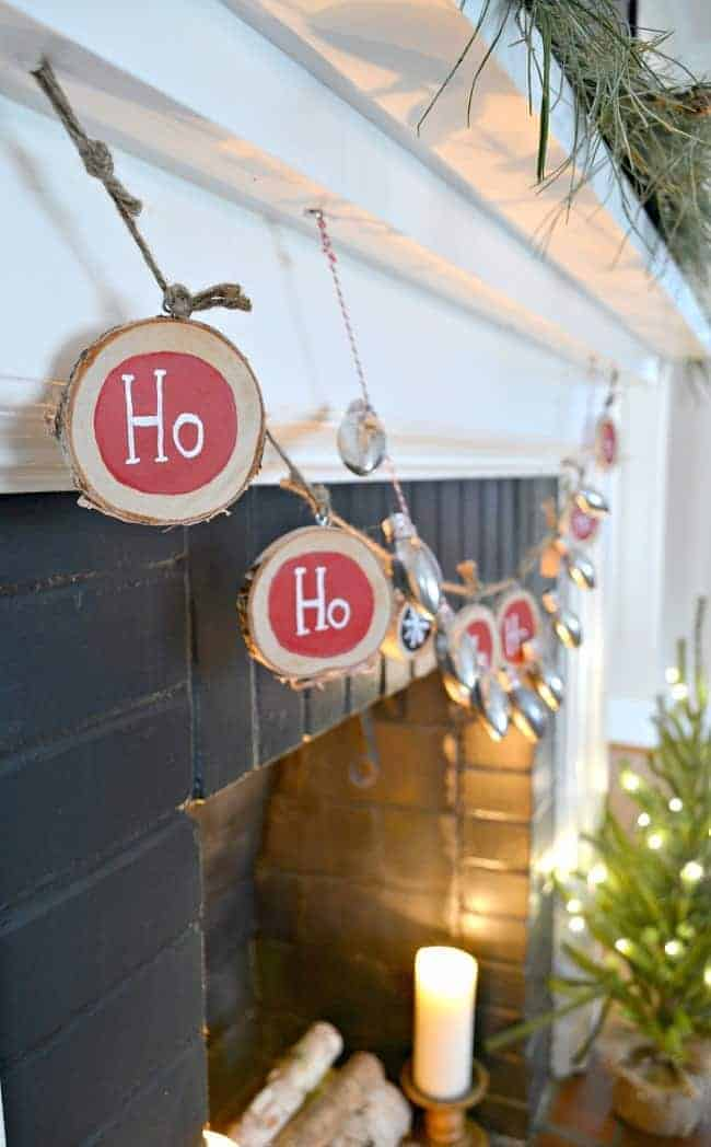 A fun and easy DIY Christmas banner made from birch wood slices and painted with red and black chalkboard paint. www.chatfieldcourt.com