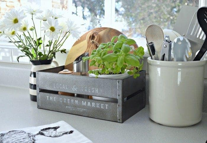 Simple organization tips using a crock to keep a small kitchen looking its best. www.chatfieldcourt.com