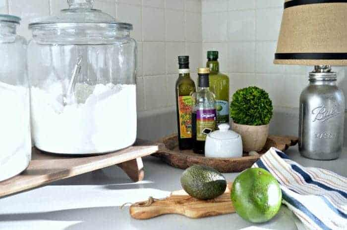 Simple organization tips using glass jars and a wooden tray to keep a small kitchen looking its best. www.chatfieldcourt.com