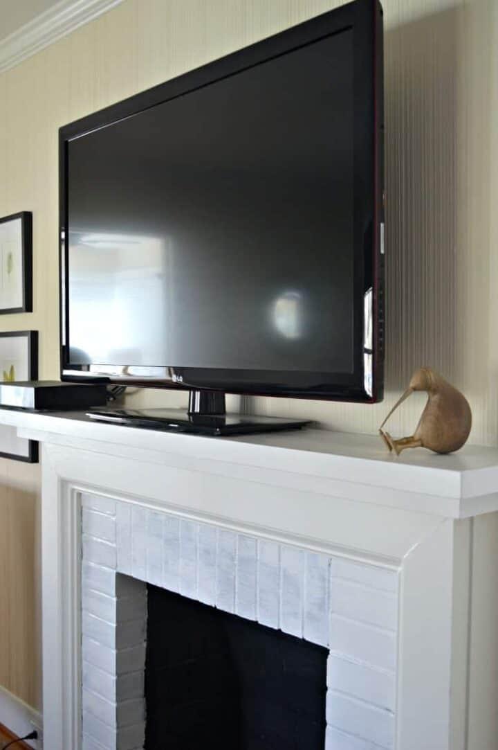 tv on new fireplace mantel