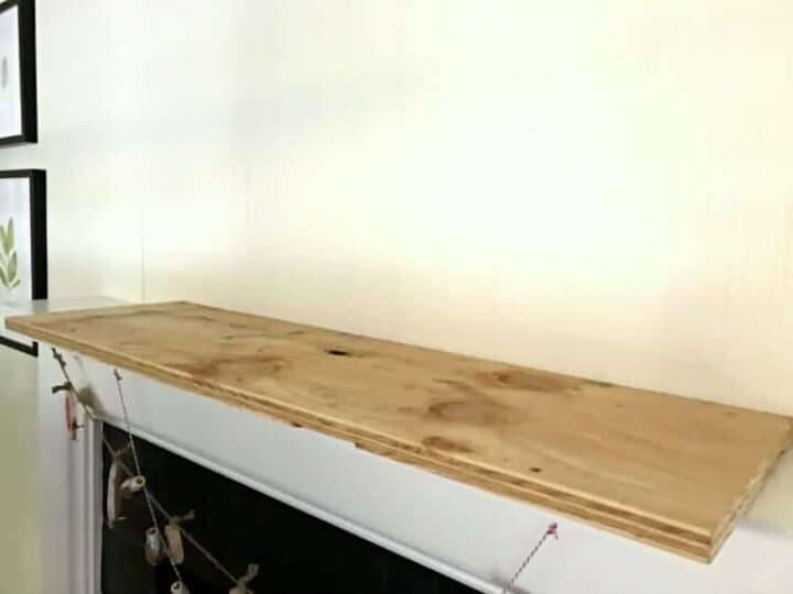 plywood on fireplace mantel