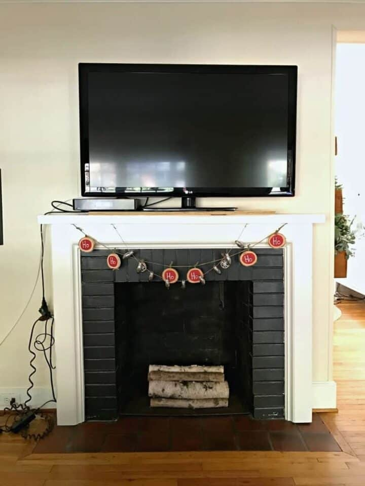 front view of tv on fireplace mantel