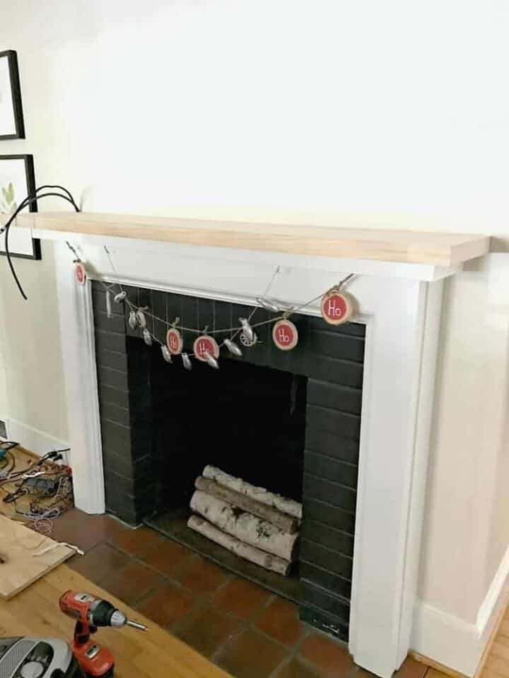 new piece of wood on fireplace mantel