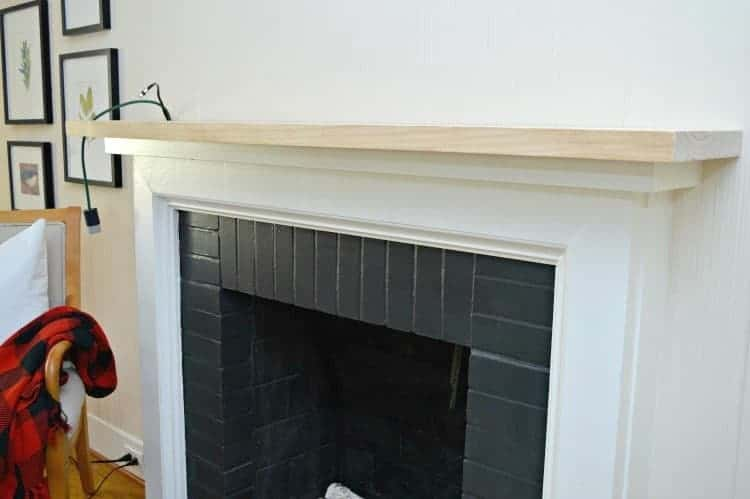 A DIY fireplace mantel makeover to accommodate a flat screen tv in a small living room. A simple and easy fix using a large piece of white pine wood.