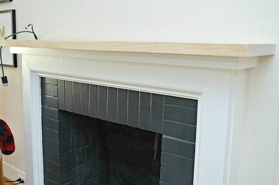 unpainted mantel attached to old painted fireplace mantel