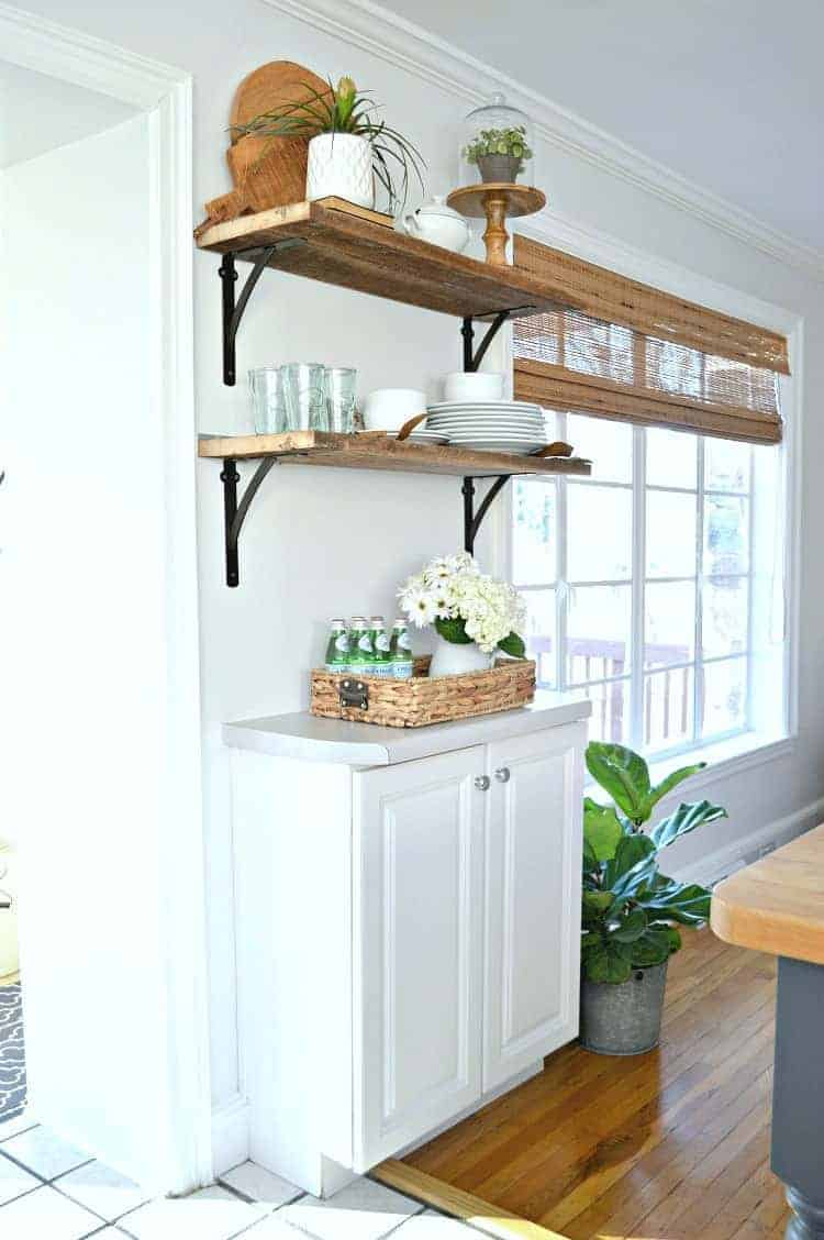 Adding DIY wood shelves to a kitchen for under $50, using old barn wood and shelf brackets from Home Depot.