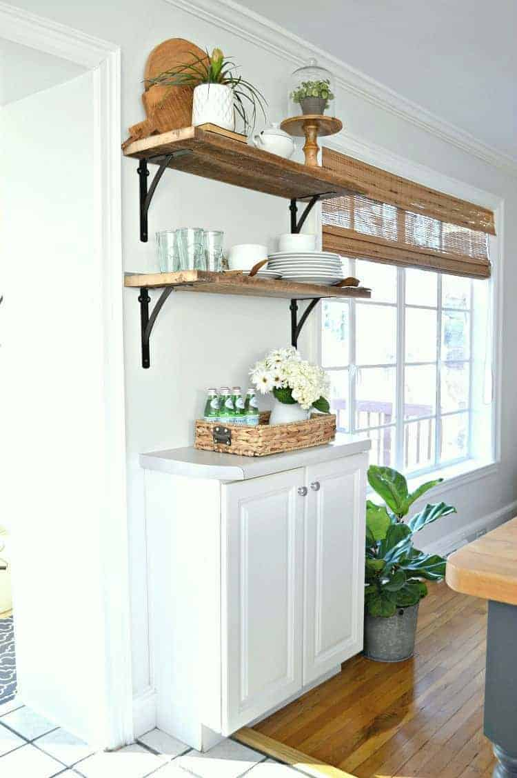 Adding beautiful DIY kitchen open shelving for under $50. A great way to add rustic, farmhouse charm instead of cabinets in the kitchen. www.chatfieldcourt.com