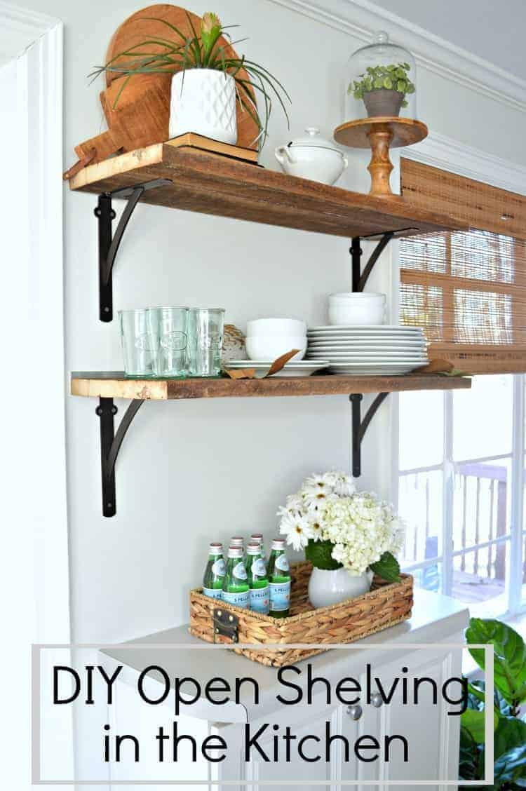DIY open shelving in the kitchen using barn wood and inexpensive shelf brackets.