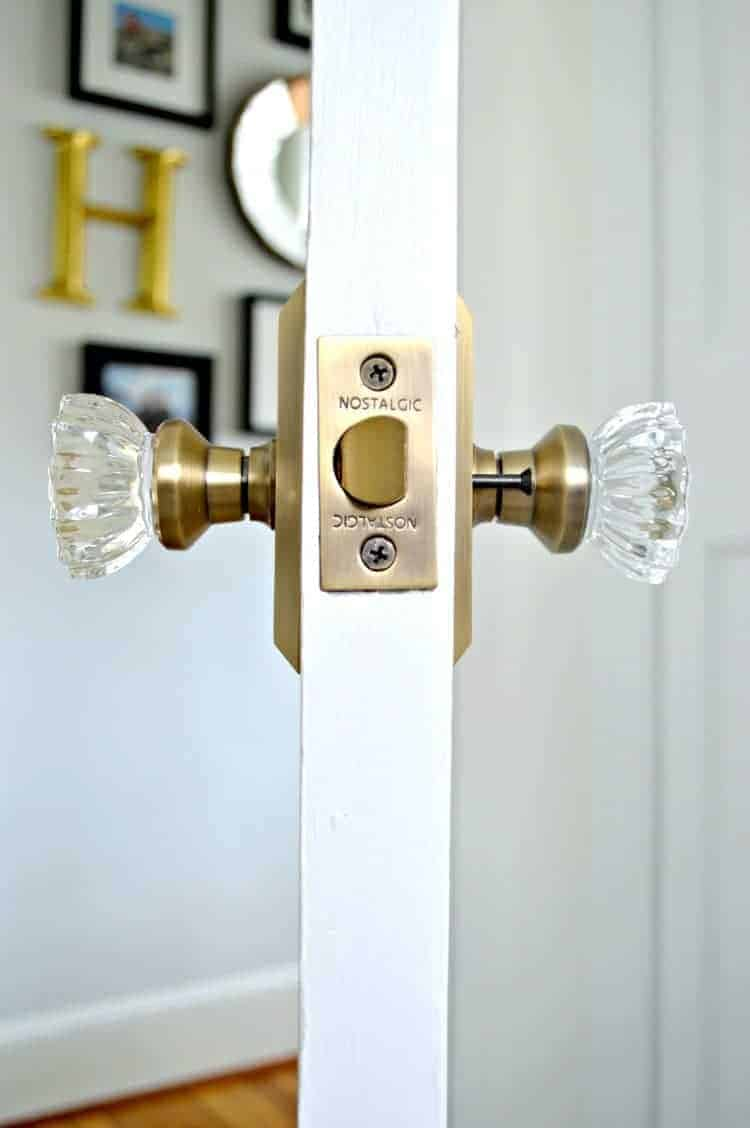 Updating 2 old doors in a 1946 stone cottage bathroom with some elbow grease, paint and beautiful new glass door knobs. An easy DIY to add vintage charm to your home. | Chatfield Court
